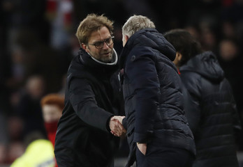 Sunderland manager David Moyes and Liverpool manager Juergen Klopp shake hands after the game