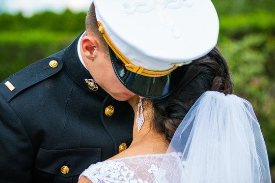 wedding military groom holding bride closeup outside