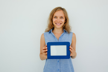 Happy Pretty Woman Holding Empty Picture Frame