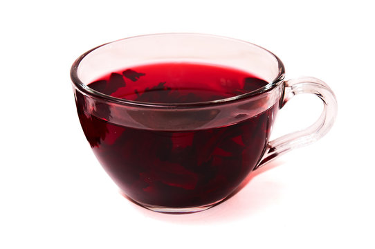 Hibiscus tea in a glass cup .
