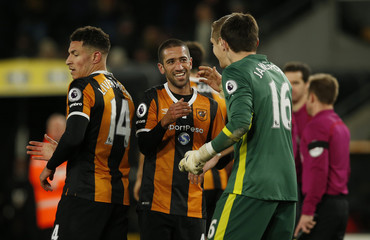 (L - R) Hull City's Jake Livermore, Evandro Goebel and Eldin Jakupovic celebrate after the game