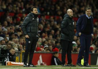 Manchester United coach Rui Faria and West Ham United manager Slaven Bilic