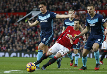 Manchester United's Henrikh Mkhitaryan in action with Middlesbrough's Bernardo Espinosa (L) and Ben Gibson (R)