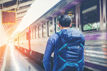 Tourist Man backpacker to travel at train station