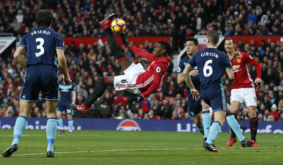 Manchester United's Paul Pogba hits the post with a overhead kick