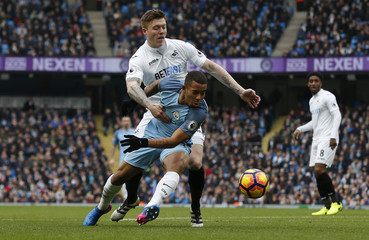 Manchester City's Gabriel Jesus in action with Swansea City's Alfie Mawson