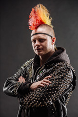 Portrait of punk rocker with Mohawk hairstyle on a black background.