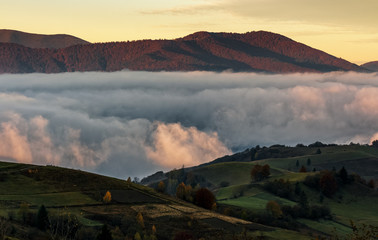 rising clouds in mountainous countryside before the dawn