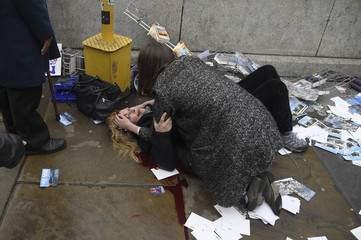 A woman lies injured after a shooting incident on Westminster Bridge in London