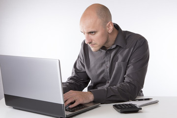 Businessman working on his laptop computer