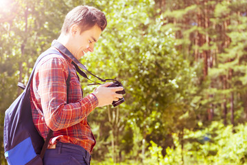 A young man takes photos of nature. Summer-Autumn.