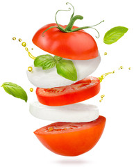 slices of tomato, mozzarella cheese and basil flying on white background