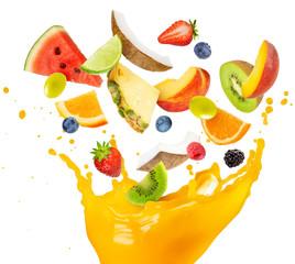 fruit salad falling into splashing orange juice
