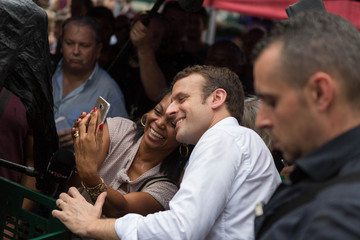 Emmanuel Macron, head of the political movement En Marche and 2017 presidential candidate poses for a selfie as he visits the Chaudron market in Saint-Denis as he campaigns on the French Indian Ocean island of the Reunion
