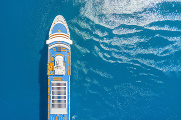 Part of a cruise liner in the blue sea, top view