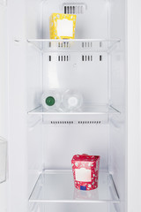Open fridge full of fresh fruits and vegetables
