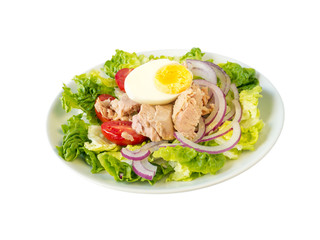 Tuna salad on the white plate side wiew