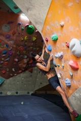 girl on the climbing wall.