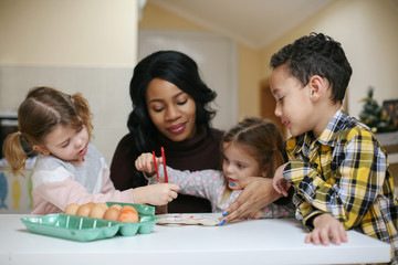 Woman with three child. African American woman with three child prepare for Easter.