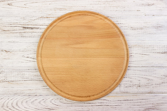 pizza cutting board at table background, Round board