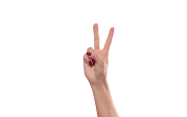 Female hand showing Victory sign