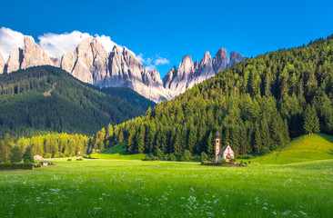 Traditional alpine St Johann church in Val di Funes valley, Santa Maddalena touristic village, Dolomites, Italy, Europe