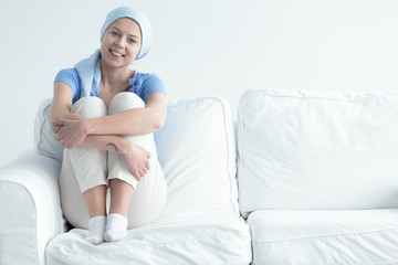Cancer survivor sitting on sofa