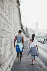 Couple in Sportswear Walking on the Street