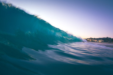 Slow shutter speed/water shot of a breaking wave at sunset.
