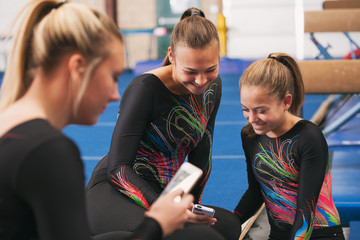 Gymnastics: Friends Take A Break To Look At Text Message