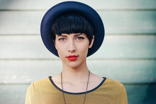 Portrait of stylish young woman in blue hat
