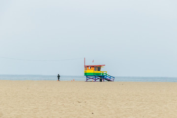 Man jogging next to the ocean
