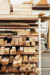 Wood on shelves at workshop