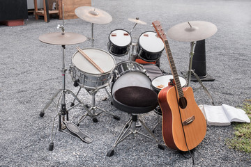 Music instrument / View of drum and guitar on the ground.