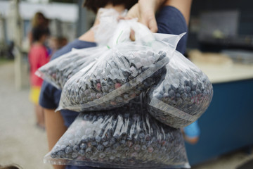 Woman carrying blueberries in plastic bags