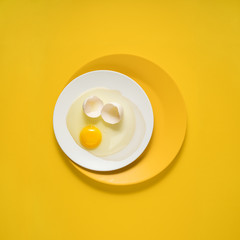 Dinner is served / Creative concept photo of kitchenware, painted plate with food on it on yellow background.