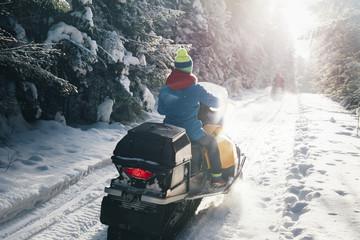 Woman riding snowmobile