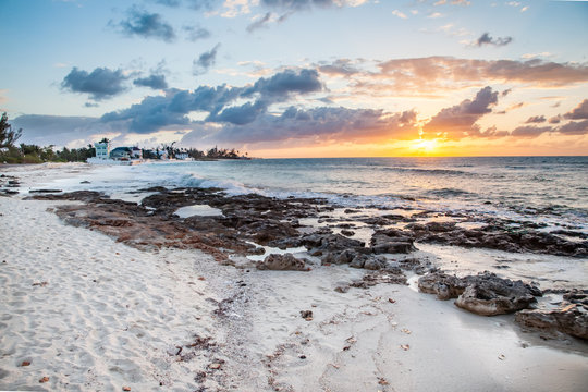 Sunset beach with rocks during low tide in Bahamas