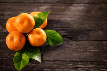 Tangerines top view on a wooden background- Mandarins.