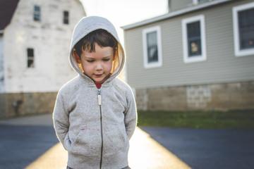 Little boy in hooded sweatshirt