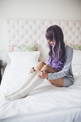 Fashionable young woman with purple hair