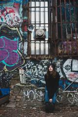 Young woman looking at graffiti