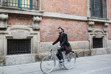 Young man riding his bike in the city center