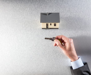 hand of businessman, home owner or realtor agent giving key