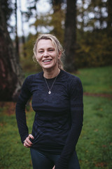 Post workout portrait of middle age caucasian woman - smiling outside