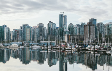 Vancouver habour cityscape with boats in the foreground.