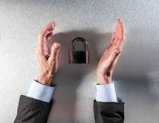 protecting businessman hands questioning corporate data security and safety