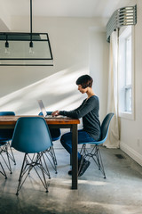Woman working at home on her laptop
