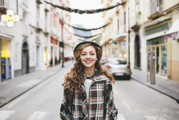 Beautiful woman on the street, smiling and looking at the camera