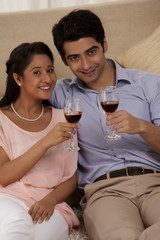 Portrait of happy couple holding wine glass together